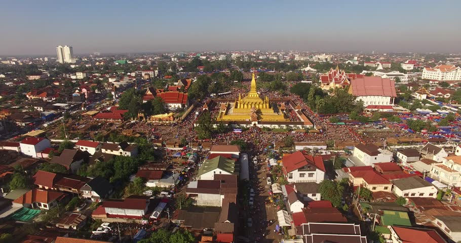 4K Aerial view of Phra That Luang Festival (Boun That Luang).Thousands of people flock to the grounds of Buddhist ceremonies and celebrations to pay respect to the golden stupa.Vientiane,LAOS. 2017