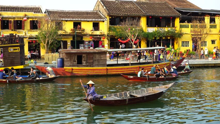 Hoi An, Vietnam - February, 2016: Wooden boats on the Thu Bon River in Hoi An Ancient Town (Hoian), Vietnam