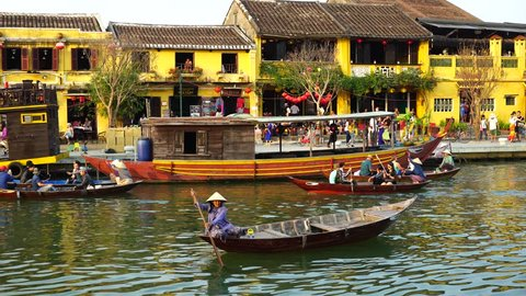 Hoi An, Vietnam - February, 2016: Wooden boats on the Thu Bon River in Hoi An Ancient Town (Hoian), Vietnam