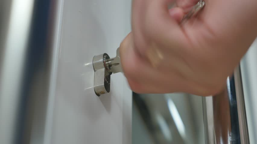 Locking up or unlocking door with key in hand. | Shutterstock HD Video #22815808