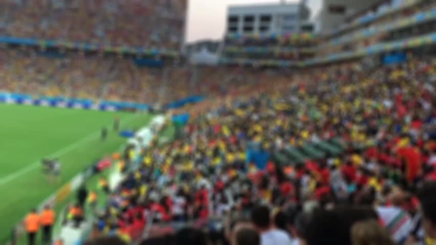 Blurred background of crowd of people in a soccer match