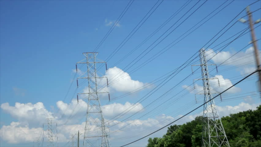 Miles of overhead power lines create a grid of electrical transmission through high-voltage wires.