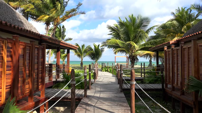 Types of the Cayo Levisa Island hotel. Bungalow & wooden walking deck. Cuba.