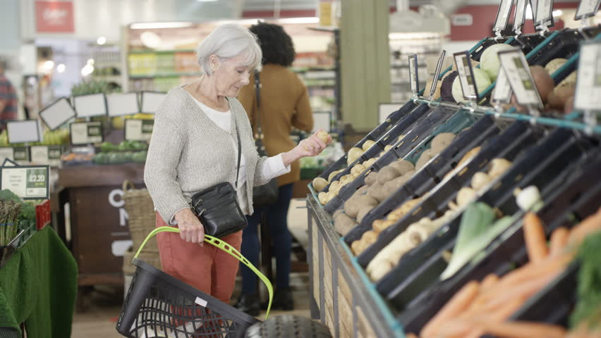 4K Cheerful senior lady shopping for groceries in the supermarket Dec 2016-UK | Shutterstock HD Video #22858138