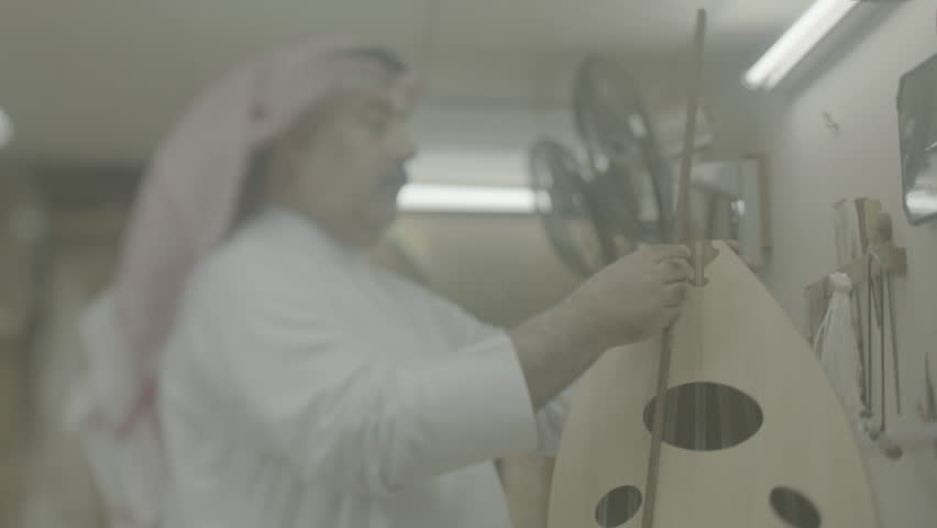 Musical Instruments: Oud Maker, Bahrain. MCU view of a Bahraini oud maker assembling the pegbox at the top of the instrument.