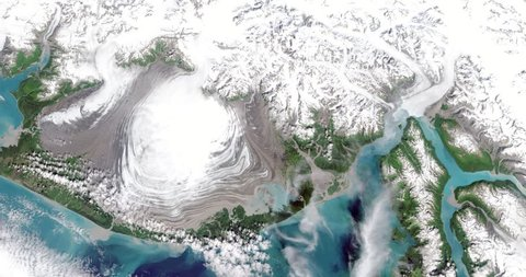 Aerial time lapse, fictional retreat of Hubbard Glacier, Alaska. Two time lapse versions in clip: 8-second/4-second. 4-second head/tail pad on each version. Elements of this image furnished by NASA