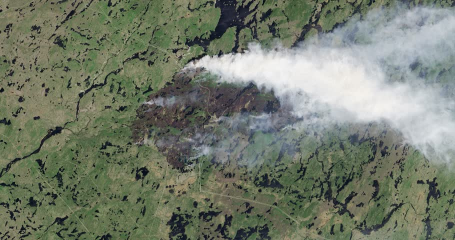 Aerial zoom out over the 2013 fires in western Quebec, Canada. Elements of this image furnished by NASA.