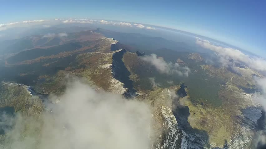 Aerial: drone airplane flying over magnificent mountain landscape. Episode 12.   Shutterstock HD Video #22892788