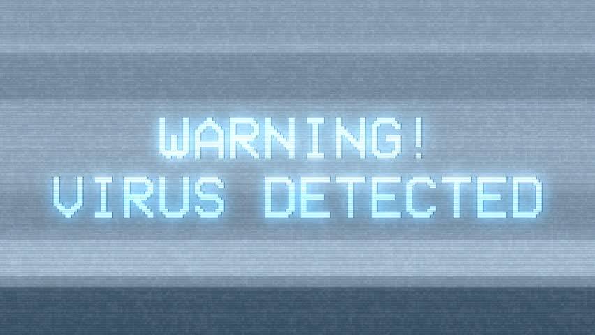 The screen of a PC showing a looping message: Warning - Virus Detected. Bright version.