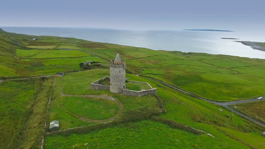 The old Dunguaire Castle in the West Ireland found in the middle of the green fields fronting the big sea and one of the tourist spots in Ireland