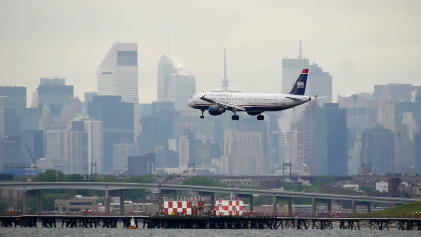 NEW YORK - CIRCA JULY 2011: US Airways Airplane Landing LaGuardia Airport New York City