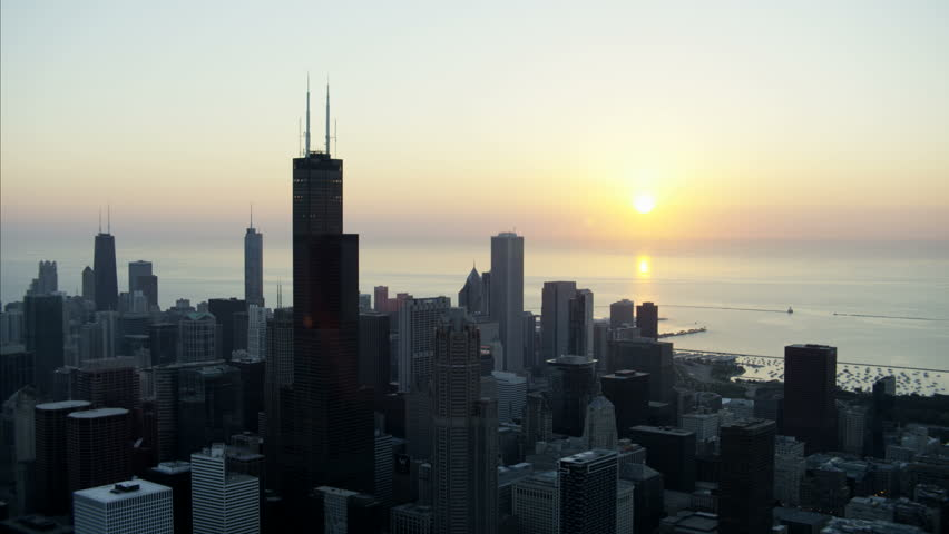 Chicago, USA - September 2016: Aerial view at sunrise of Lake Michigan Willis Tower Chicago Skyscraper buildings Downtown Financial District Illinois sunlight RED DRAGON   Shutterstock HD Video #22988458