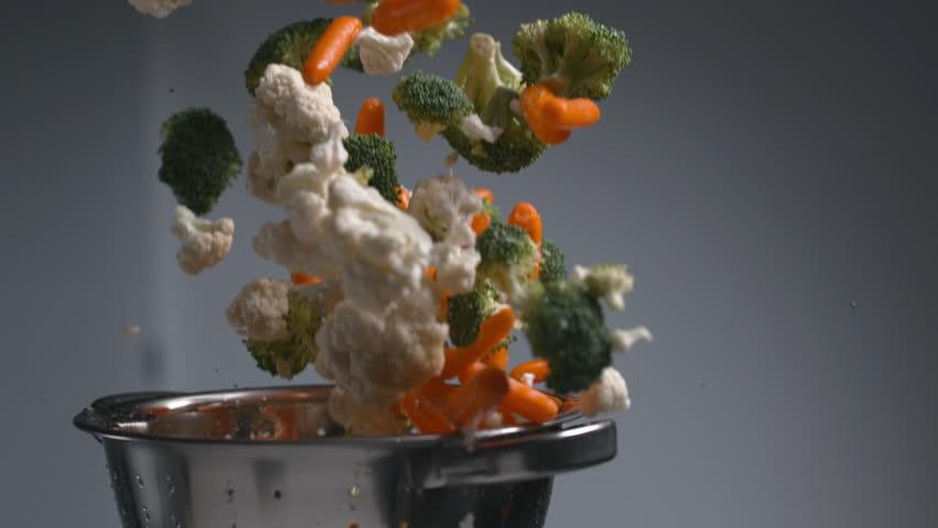 Vegetables flying out of colander in super slow motion, shot on Phantom Flex 4K | Shutterstock HD Video #23013274