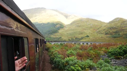 Glenfinnan Railway Viaduct in Scotland with the Jacobite steam train in Scotland, UK