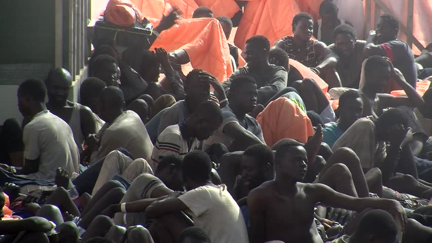 MEDITERRANEAN SEA, -ITALY – OCT 25: African and arabic migrants on a rescue vessel after an rescue operation on international sea in italy 2016   #23040598
