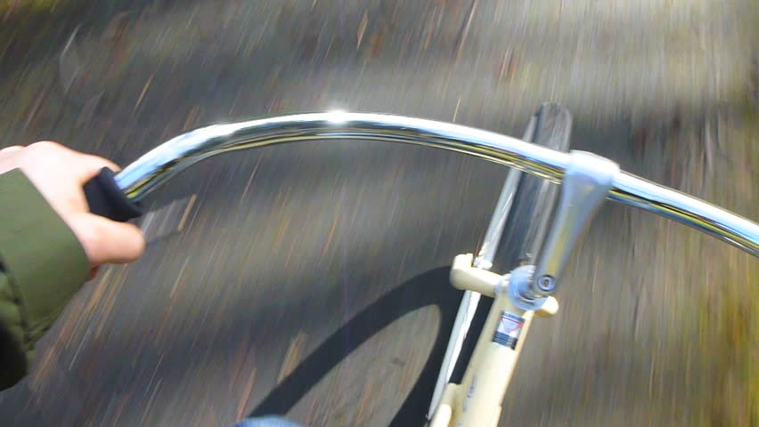 Point of View while riding bicycle on paved trail.