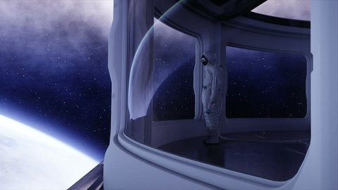 alone astronaut in futuristic spaceship, room. view of the earth. cinematic 4k footage.