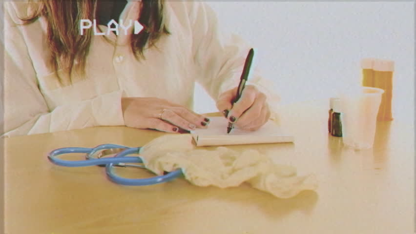 VHS Retro Fake Shot A Female Doctor Removing Her Gloves To Write Prescription