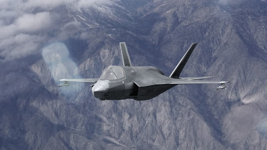 4k F-35 Fighter Jet over the mountains firing a missile and then peeling away stock video clip. Joint strike fighter