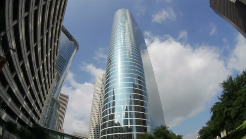 The fisheye lens distorts the circular skywalk of a metropolitan Houston making it bend a curve back upon itself.