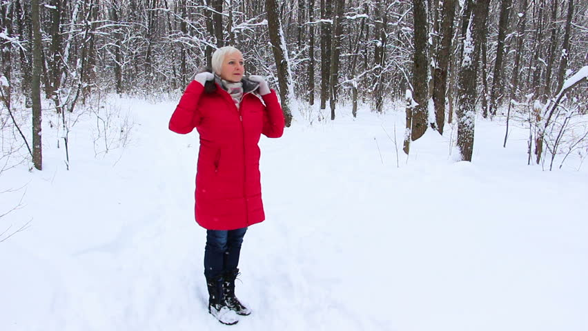 Attractive Senior Woman In The Winter Snow Wood In Red Coat Having ...