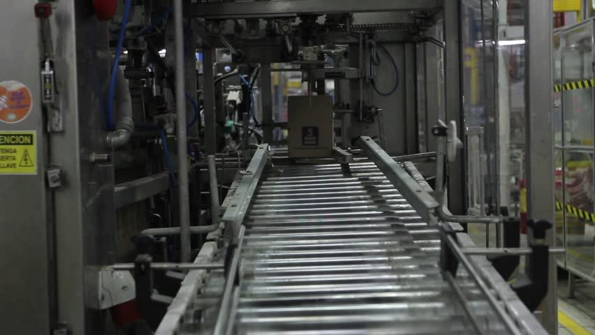 Wide head-on shot of conveyor belt spitting out a medium-sized box. (Santiago, Chile - Feb 2016) | Shutterstock HD Video #23165818