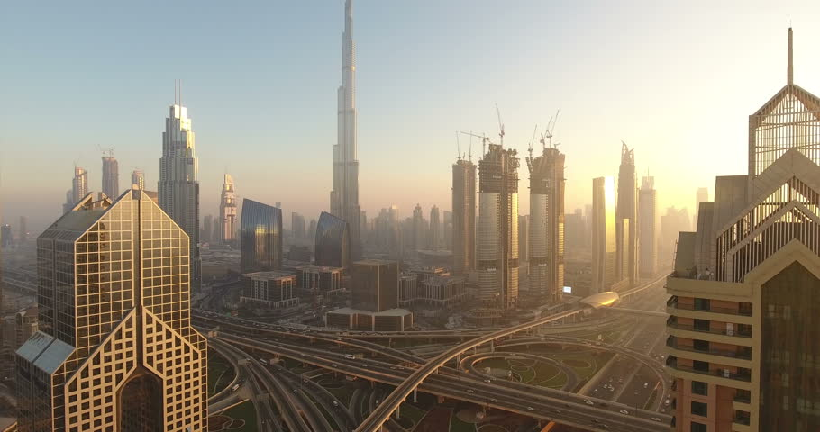 DUBAI, UAE - JANUARY 2, 2017: Aerial view of Burj Khalifa downtown Dubai at sunset. The Burj al Khalifa is the tallest structure in the world, standing at 829.8 m (2,722 ft). Scenic dusk 4K scene.