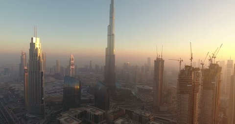 DUBAI, UAE - JANUARY 2, 2017: Aerial view of Burj Khalifa downtown Dubai at sunset. The Burj al Khalifa is the tallest structure in the world, standing at 829.8 m (2,722 ft). Scenic dusk 4K scene.