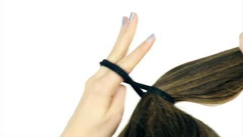 Long hair tied up in ponytail slow motion isolated closeup