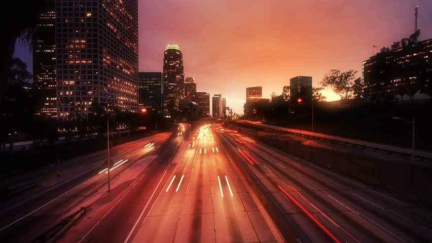 Los Angeles freeway traffic at sunset. Timelapse.