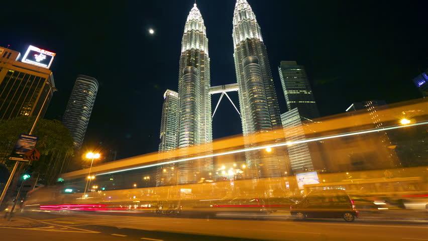 KUALA LUMPUR - MAY 3: (Hyperlapse view) Traffic and pedestrians near The Petronas Towers on May 3, 2012 in Kuala Lumpur, Malaysia.