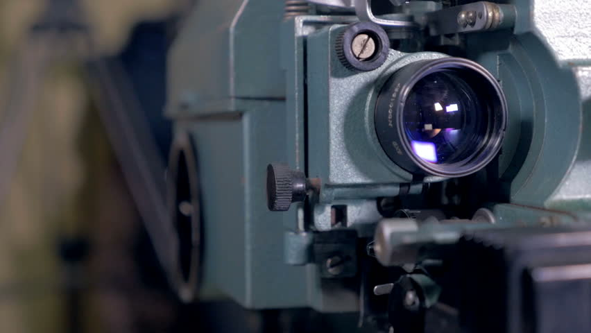 Worker switch on antique Film Projector. | Shutterstock HD Video #23217748