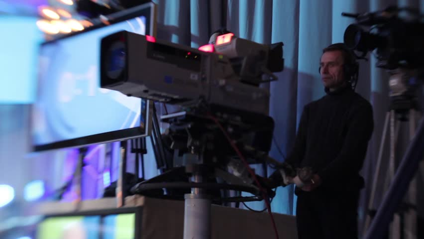 KYIV, UKRAINE - MAY 2, 2015. Cameraman with a large camera shoots a show in the TV Studio