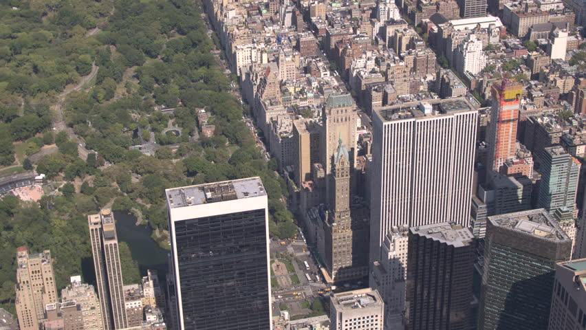 AERIAL CLOSE UP: Sunny New York city midtown Manhattan with contemporary glassy skyscrapers and condominium apartment buildings overlooking beautiful green Central park. Busy crowded NYC in America | Shutterstock HD Video #23257828
