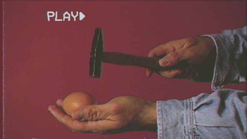 VHS retro fake shot: two ways of breaking an egg; with another one; with a hammer.