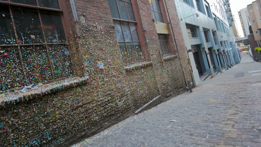 SEATTLE, USA - MAY 12, 2012: Timelapse of People walking by the gum wall on Post