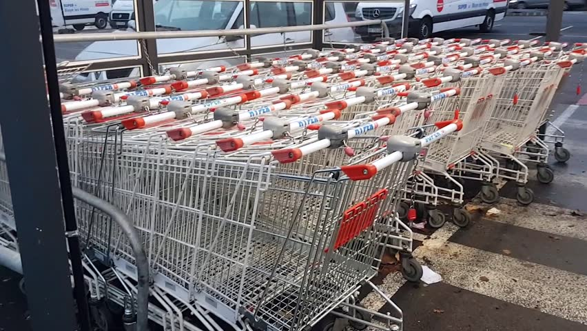 Blaye-les-Mines, France, January 15, 2017: In Front Of A Supermarket Shopping Carts Are Ready For Customers.