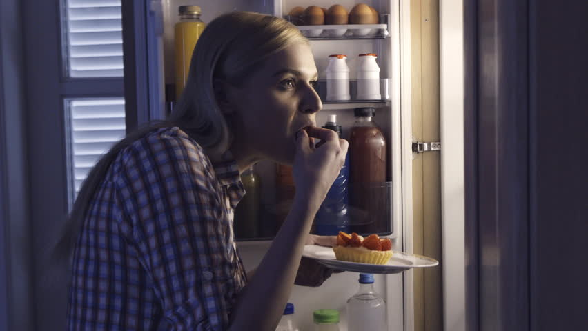 Woman Taking Tart From Fridge