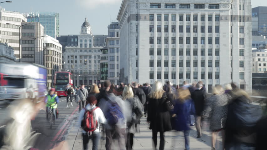 Time-lapse of rush hour commuters and traffic on London Bridge