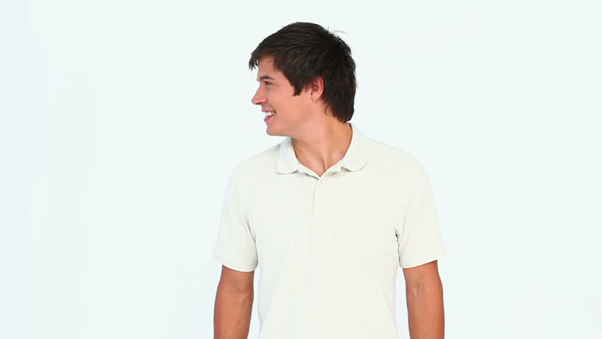 Man turning his head back and forth against a white background