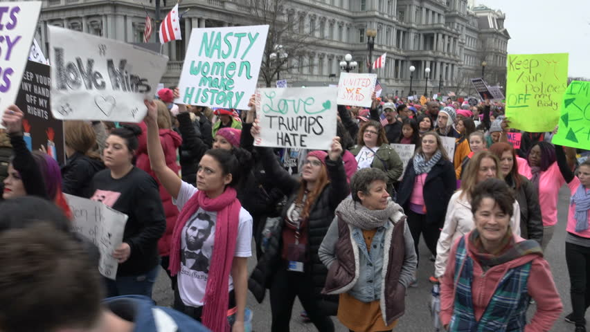 "WASHINGTON, DC - JAN. 21, 2017: Women's March on Washington on 17th St. near White House; ""Donald Trump Has Got to Go"" chant, part of gigantic turnout that flooded DC in show of solidarity."