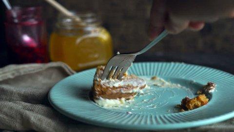 Man eating dessert dish. Finished eating cake. Eat dessert cake slice. Sweet breakfast. Eating freshly baked cake with fork. Carrot pie slice eating with fork