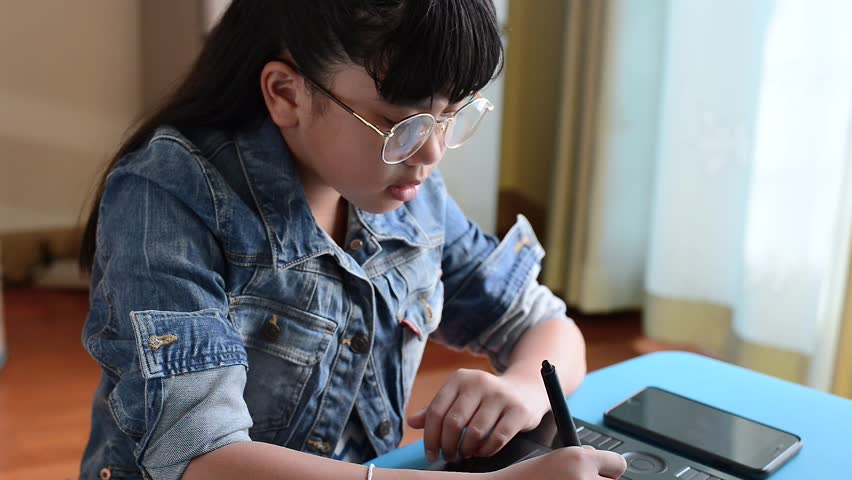 Young happy girl creative designer is working with graphics tablet , creating digital art | Shutterstock HD Video #23449468