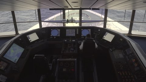 Cruise ship at sea. Captain bridge or control room inside view