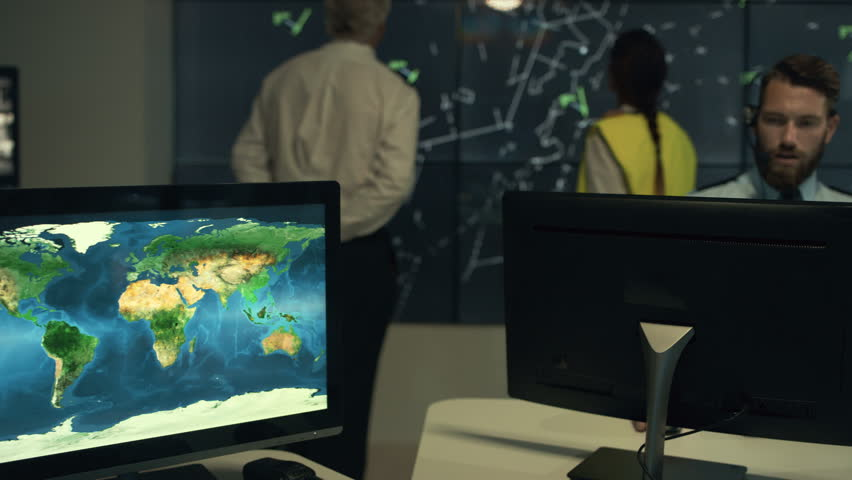 Young teacher using interactive whiteboard to display the world 4k security staff watching screens amp discussing in observation control room 4k stock video gumiabroncs Gallery