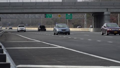 Slow motion traffic on long island expressway during rush hour commute  day  time exterior  3 lane highway with carpool lane  shot 120fps high frame  rate  roadway connecting to manhattan new york city