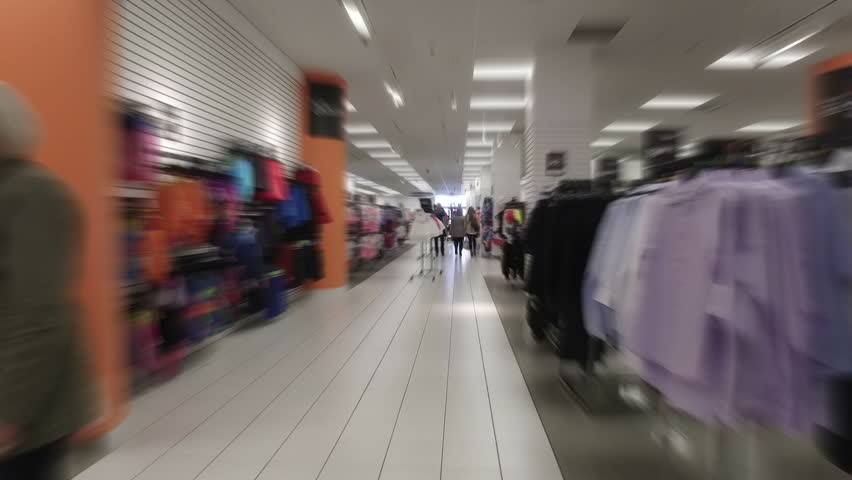 MONTREAL, CANADA - JANUARY 2017: Smooth & steady slow motion blurred walk-through shopping mall clothing store | Shutterstock HD Video #23475838