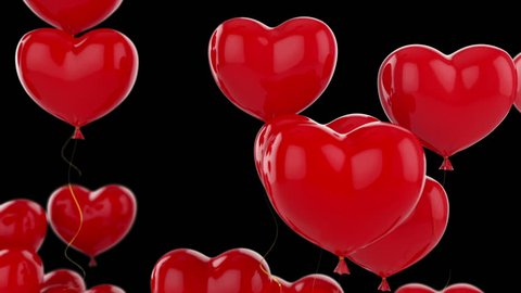 Floating red hearts on black background animation for Valentine's day