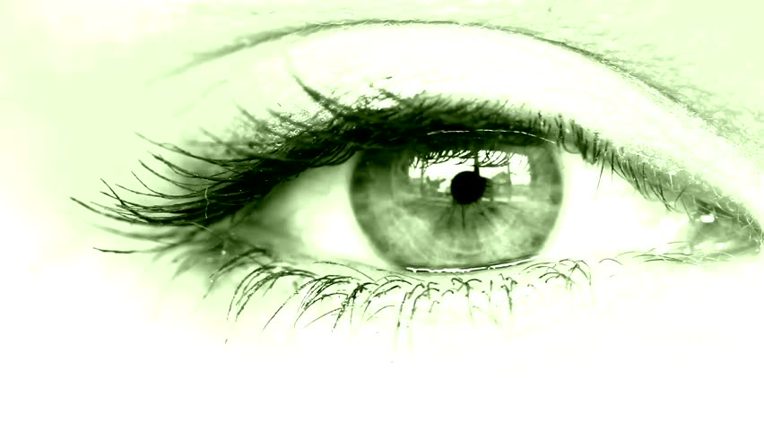 women's eye close up looking around green tinted