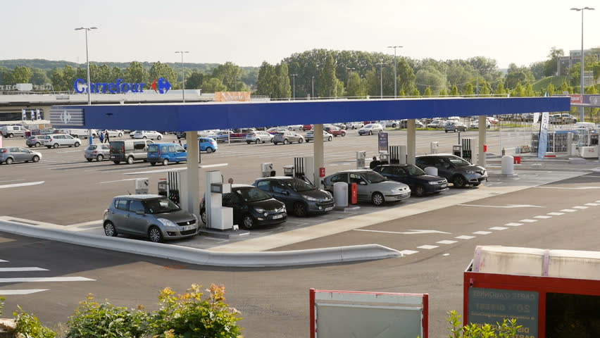 L'Isle-d'Abeau, France - Circa 2017: Still elevated view of self French gas station at Carrefour Hypermarket zone with cars filling gas and diesel for the best price in town